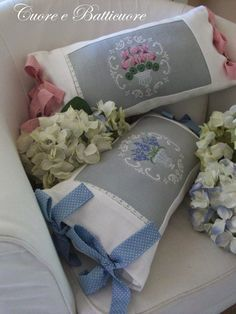 cross stitch flower pillows with bow trims
