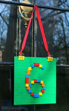"Lego ""wreath"" to welcome guests to the party."