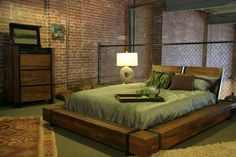 Sweet Bedroom with Reclaimed Wood Bed: Reclaimed Wood Bed In Inspiring Industrial Bedroom Design With Chain Link Fence And Brick Walls Also White Shag Rug With Cool Bedside Lamp And Decorative Pillows Plus Floor Cushions ~ franklester.com Bedroom Inspiration