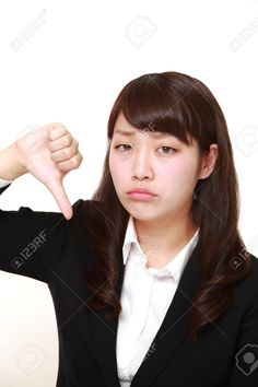 Picture of young Japanese businesswoman with thumbs down gesture stock photo, images and stock photography. Japanese Office Lady, Office Ladies, Business Women, Stock Photos, Photography, Photograph, Fotografie, Photoshoot, Fotografia