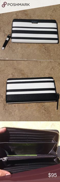 """Kate Spade Neda Wallet NWT Kate Spade Neda Wallet. Black and white stripes.  Zip closure opens to 12 card slots, zip pocket, 3 gusset pockets, and 2 bill slots.  7.75' x 4"""".  NWT. Comes with Kate Spade care card.  NO TRADES kate spade Bags Wallets"""