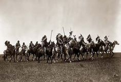 Here we present a rare image of an authentic Brule Indian War Party. It was taken in 1907 by Edward S. Curtis.    The image shows Brule Indians, many wearing war bonnets, on horseback.    We have created this collection of images primarily to serve as an easy to access educational tool. Contact curator@old-picture.com.    Image ID# 8FAA108E