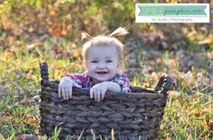 Love using the basket to 'contain' a new little walker during a one-year photo session!    Studiosblog.com