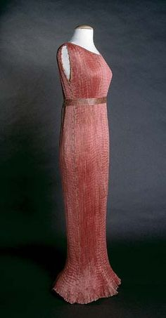 Fortuny Tea Gown, 1936, National Museum of American History.  This dress is made of finely pleated rose-colored silk with silk cording along side seams, and multicolored glass beads threaded through the cording.  Named after a Greek classical sculpture, the Delphos Gown was a simple column of vertical pleats permanently set in silk by a process never successfully duplicated.