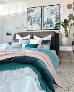"""Bedroom art prints: Contemporary modern Scandinavian Australian bedroom styling with grey blue and pastel pink featuring linen by Adairs and original artwork and styling by Australian artist Kate Fisher Art. """"Nordic Sky I & II"""" art prints."""