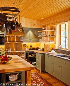 Design: Whitten Architects - I love the green cabinets and wood island :)