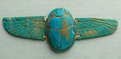 Winged scarab.