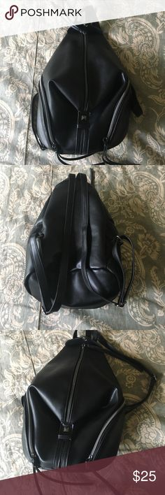 Black backpack purse Franchescas Black backpack purse from franchescas (stongly resembles Rebecca Minkoff backpack). Used a few times, in good condition. Francesca's Collections Bags Backpacks