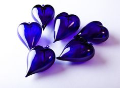 Blue glass hearts.I love the color..red would be fantastic also...a rainbow of colors...Why YES yes...I would like that very much.....my my my I love HEARTS...