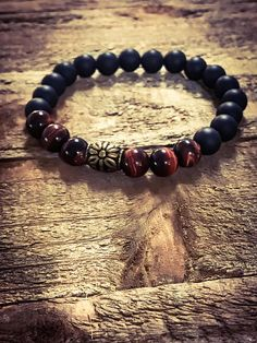 Bracelet For Him, Beaded Jewelry, Mens Bracelet. Designed and created by theuniqueu, this very simple bracelet was created using 8mm Matte Black Onyx Beads 8mm Red Tiger Eye Beads. I would be delighted to do custom or bulk orders. I would need an advanced notice so I can fulfill your