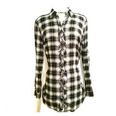 Ruffle Front Flanel Belted Tunic Black and white flannel button down tunic by Faded Glory has a ruffled front and comes belted with the option to tie it in front or back or wven remove it.  Sleeves can be buttoned up to a half sleeve.  This top is super soft and if paired with leggings is even long enough to be worn as a dress.  A closet staple from my smoke free home. Faded Glory Tops Tunics