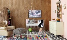 Nothing can steal the attention from an adorable baby, but Ajiro Chevron wall covering comes close. A unique yet understated backdrop, this wood veneer wall covering has all the simplicity of a regular wood panel but is a cost effective and environmentally friendly choice. Designed by Jamie Laubhan-Oliver. Learn more about Ajiro Chevron at: http://www.mayaromanoff.com/product/ajiro-chevron