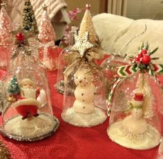 A great idea to make Christmas scenes in domes from plastic wine glasses found at the dollar store.