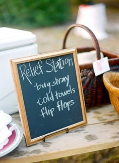 Keep outdoor wedding guests comfortable with a relief station. Don't forget bug spray, cold towels and flip flops.
