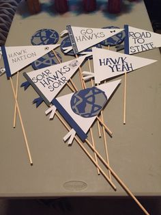 Pennants and soccer balls on dowel rods. We taped them to bus windows