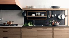 Valcucine - Sine Tempore  Gabriele Centazzo's Sine Tempore kitchen system in solid elm with copper hood by Valcucine, 39-434-517911
