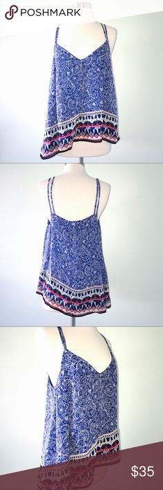 French Connection Bali Border Tank Size 8 An  eclectic mix of colorful floral and geometric prints adds global flare to FRENCH CONNECTION's breezy strap-happy top.  V-neck, sleeveless, double spaghetti straps looped through silver-tone grommets at front and back Allover print, asymmetric hem with contrast print border, pullover style  Excellent Condition, no flaws or signs of wear to note. Still retailing at Bloomingdales SRP $108 French Connection Tops Tank Tops