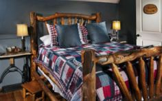 The Oregon Trail Room has a rustic queen-sized log bed, skylight and private, attached bathroom with jetted tub.