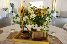 Table arrangement with florals and vintage items *Creative Touches Evansville*