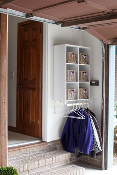 Do you need a mudroom in your home, but don't have the space for one? Why not create a mini mudroom on a wall in your home to hold and organize your stuff.   In My Own Style