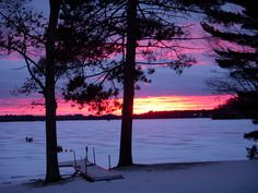 Sunset over frozen lake. Eagle River, WI