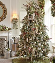 Christmas Tree with a lot of foliage, icicles, and a fluffed up topper looks fantastic