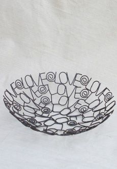 These wire bowls are crafted in a cooperative in India that are working their way out of poverty, breaking the cycle for their children through a steady income.  The co-op also helps to provide health care, clean water, and education opportunities to surrounding villages. 11 inches    Made in India - 11inches