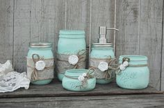 Rustic mason jar bathroom jar set. Hand painted in soft mint green, lightly distressed, wrapped with burlap and lace, tied with jute and white roses and finished with a protective coating. Metal soap