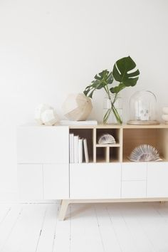 Absolutely love this cabinet. The mix of pine and white + no handles. Incorporate aspects of this in TV lounge cabinet.
