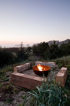 fire pit and carved log benches
