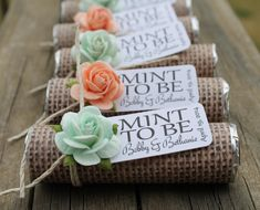 Mint wedding favors. Wrap rolls of mints with burlap and attach country flower and tag.