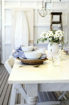 White and blue styled table with board and batten walls.