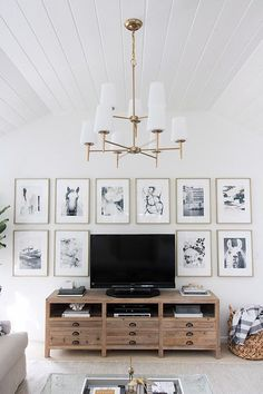 Great idea for decorating around your TV - hang similar sized art pieces in a grid around it! Post is full of awesome Before and After pics!