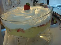 A party staple at my house. Punchbowl cake: Angel food cake, vanilla pudding, bananas, crushed pineapple, sliced strawberries, topped with Cool Whip. Repeat if desired.