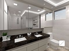 Banho casal com armário em espelho ocupando toda a largura da parede, dando uma sensação de continuidade e ampliando o ambiente