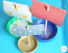 Bottle Lid Boats and lots of other fun boat crafts for kids.