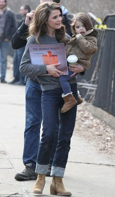 Doting mom: Keri cuddled her two-year-old daughter Willa on the set of The Americans in New York City last Tuesday