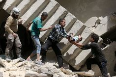 Syrian civil defense volunteers and rescuers remove a baby from under the rubble of a destroyed building following a reported air strike on the rebel-held neighborhood of al-Kalasa in the northern Syrian city of Aleppo, on April 28. Despite a partial ceasefire attempted early in the year, the complex Syrian Civil War continued throughout 2016, now approaching six years of conflict, leaving entire cities in rubble, thousands dead, and even more driven from their homes.