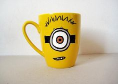 Hi there! Im the Minion Mug and I belong to the Marmade family of mugs Im ceramic and handpainted and I was made to make your days brighter and