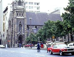 Mustang parked at a very different looking Greenmarket Square, Cape Town. Gothic Metropolitan Methodist Church in the background, built in 1880.