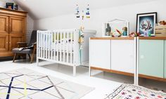 The Socialite Family | #baby #bed #room #mobile #all #white #wood #pastel #thesocialitefamily