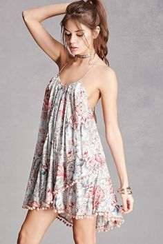 ebd1ee4c65 A woven halter mini dress by Z amp L Europe™ featuring an allover floral  print