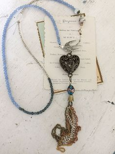 hallows~upcycled repurposed assembled beaded boho statement necklace, tassel necklace, antique beads, bird, heart pendant, glass beads
