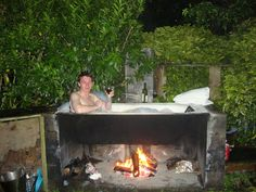 A bath outside......heated by fire by willposh, via Flickr and baked potatoes after?