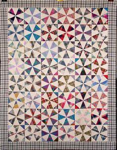 Kaleidoscope Quilt using madras and homespuns and muslin