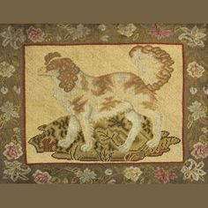 A Victorian wool and cotton needlework picture of a Spaniel stitched in gros point with a foliate border, framed, height 17 1/2 x 23 1/4 in. (44.4 x 59.0 cm.)