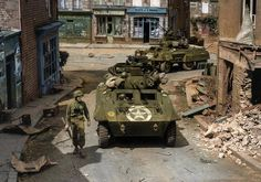 US Army . Two M8 armoured cars of the 82nd Armored Reconnaissance Battalion patrol in the streets of Saint-Sever
