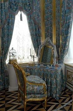 ornate fabric in drapes and vanity skirt