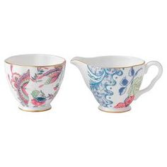 """Brimming with garden-chic appeal and timeless style, this beautiful fine bone china creamer and sugar bowl set is perfect for your next Sunday brunch or ladies' luncheon.  Product: Creamer and sugarConstruction Material: CeramicColor: White, gold, pink and blueCleaning and Care: Dishwasher safeDimensions: 3.4"""" H x 4.1"""" W (creamer)"""