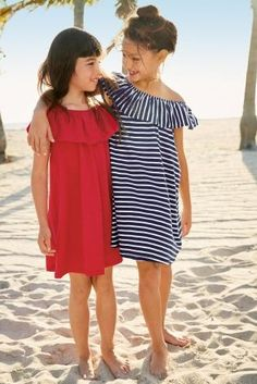 Bardot dresses for the win..! Whether strip or red, your little one will NAIL her beach look with one of these!